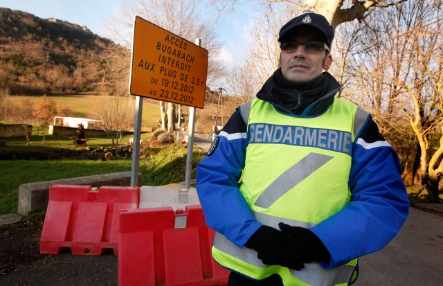 Gendarme at the Bugarach roadblock. [Patrick Aventurier/Getty Images]