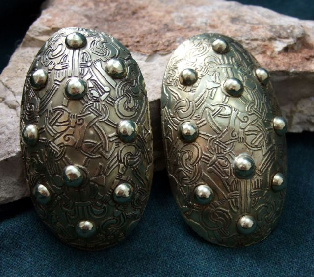 """Modern reproduction of """"tortoise style"""" brooches found in a grave on Barra Island. These attached over-the-shoulder straps to the front bodice of a woman's outer dress. [northstararmoury.com]"""