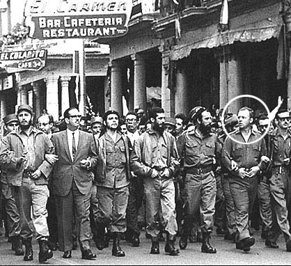 Memorial ceremony for la Coubre. Castro at left, Che toward center, Morgan on the right (circled).