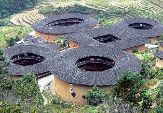 Tulou cluster at Tianluokeng, Construction began in 1796. The square building at center was burned by bandits in 1936 and later rebuilt. The round buildings have three stories with 26 rooms each. [all photos on this page are from Wikimedia Commons unless otherwise tagged.]
