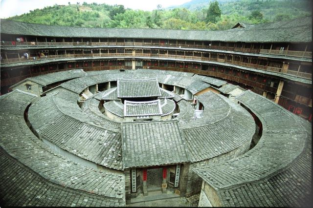 Three rings nested inside the wall of Chengqilou, built 1709. The outer ring has four stories of 72 rooms each. The first inner ring has two stories with 40 rooms each. The one-story second inner ring was used as a community library and has 32 rooms. The final inner ring is an ancestral temple.