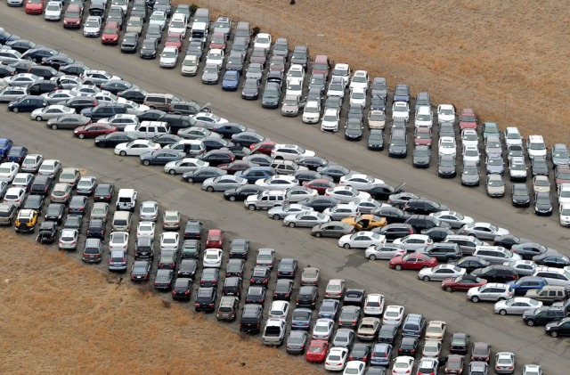 Some of the 15000 vehicles damaged during Hurricane Sandy lined up on a New Jersey air strip. [Stan Honda/AFP/Getty Images]