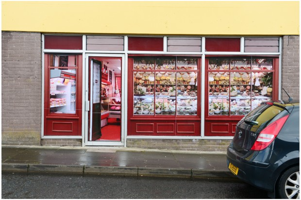This used to be a butcher shop, now it just looks like one. Those are photos of meat in the window and a fake display inside. [photo: Bryan O'Brien for the Irish Times]