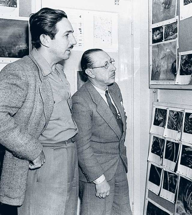 Disney and Stravinsky studying drawings of dinosaurs in 1940. Does Igor look happy?
