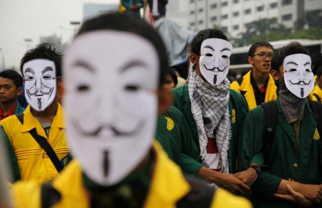 Protestors in Jakarta wearing printed masks. [Reuters]