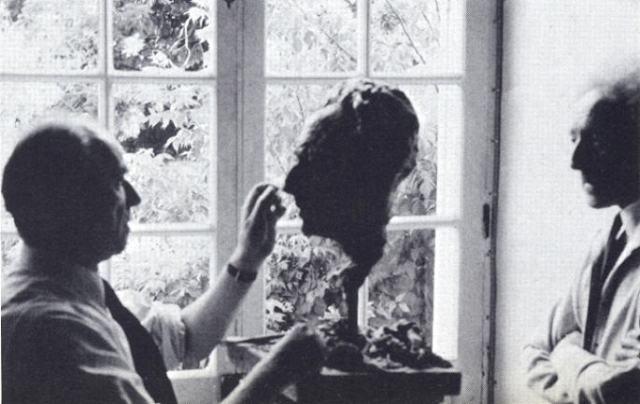 Arno Breker sculpting Cocteau.