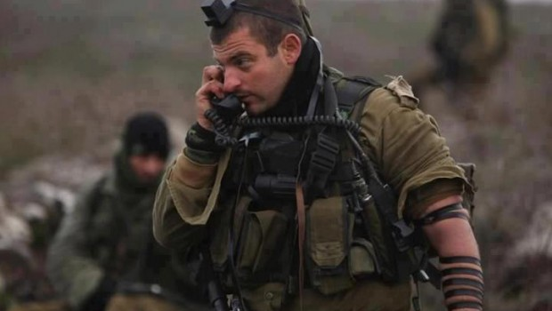 """""""Tefillen"""" are the straps used to attach phylactery prayer-boxes, as on this Israeli soldier. Cocteau is saying that they should be used to strangle Jews."""