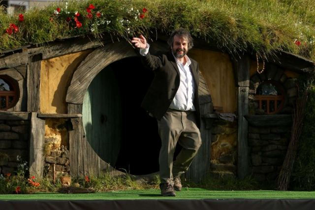 Peter Jackson outside a NZ hobbit house. [ABC]