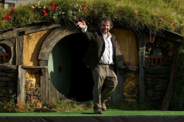 Peter Jackson outside a NZ hobbit house. [ABC]