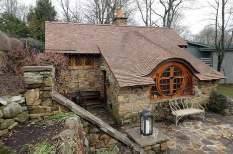 House built by Pennsylvania architects to house Tolkien memorabilia of a collector. That's right, no one lives there! See above link for interior shots -- they are cool!