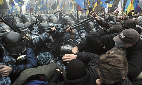 November, 2013. Riot police and protestors in Kiev after the announcement that Yuchenko's government would not sign the EU agreement. [Guardian]