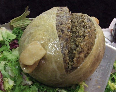 A true haggis, turning its back on vegetables. A sheep's stomach stuffed with liver, lights, heart, and whatever else might be inside a sheep. Serve with whisky. And a deep-fried Mars bar.
