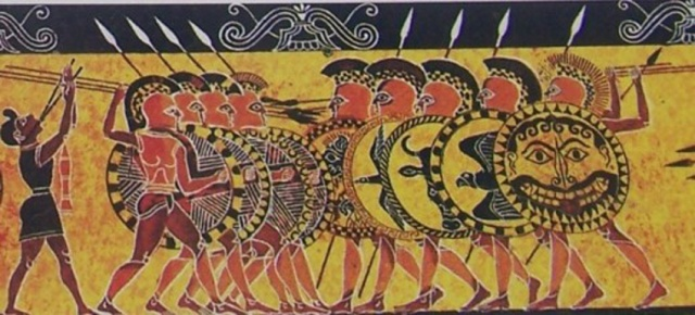 Greek hoplites at war. The Spartans used flute-players to help coordinate their movements. [via http://cliojournal.wikispaces.com/Hoplites]