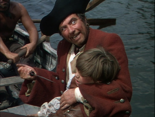 Robert Newton and Bobby Driscoll on the way to the island, before Jim gets away. Good old charming Long John Silver. Even the movie can't completely whitewash him.